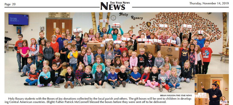 Holy Rosary students help spread Christmas joy