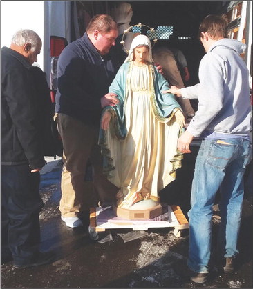 Vandalized statues return to  Neillsville church for Christmas