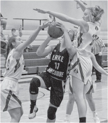 Lady Redmen hold on to earn win number one