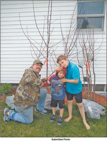 Youth takes on job of replanting trees taken by tornado