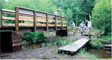 Crew comes together to build Ice Age trail bridge