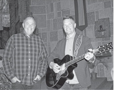 Duo shares songs of faith and action at Holy Rosary